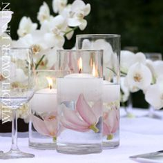 Blush pink flower floating under candle