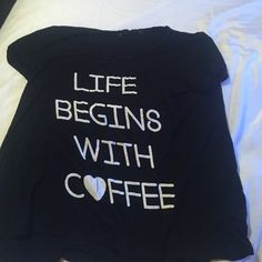"""Black short sleeve, wide shirt Black short sleeve wide shirt, size medium, saying """"life begins with coffee"""", in great condition Tops Tees - Short Sleeve"""