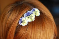 polymer clay flowers on a headband. So pretty