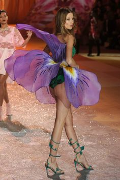 """For the last sequence, """"Angels In Bloom,"""" the models wore elaborate flower costumes. There's Behati Prinsloo."""