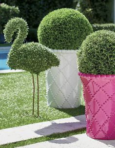 Yes, flamingos are trendy right now, and yes, our exclusive Faux Boxwood Flamingo is perhaps the coolest and most tasteful way to add the fun of one to your outdoor world.