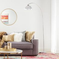 A bold floor lamp is the perfect punctuation to your decor space. This chic arc lamp is a nod to Mod style and adds drama and focused lighting where you want it.
