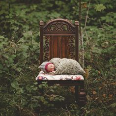 Old chair, messy woods, me, dressed nicely. Not a baby. Me.