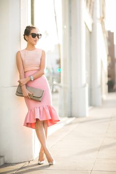 Wendy Nguyen is wearing Top from Jonathan Simkhai, pink peplum skirt from ASOS, Shoes from Jimmy Choo, Bag from J.Crew and sunglasses from K...