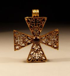BYZANTINE GOLD AND GARNET OPENWORK CROSS, 12th century A.D.