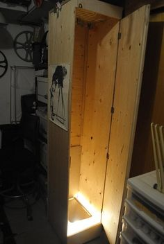 Film drying cabinet   I used to have a film drying cabinet that I made from an 8-foot tall metal locker and a wall-mounted electric hand-dryer (the kind you see in public restrooms). But the high-end stainless steel lockers are so cheap (when you can find them) that there's no reason not to go that route – and they're more efficient. The tall, narrow dryers are good for rollfilm and 35mm film, but wider ones are better for drying sheet film. ~Camerosity