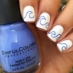 With this beachy nail art, you don't have to live on the coast to catch a wave. Plus, it's perfect for shorter nails. Just make sure you use a very fine brush.