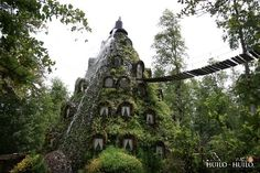 Hotel La Montaña Mágica (Huilo/ Chile): In the middle of a native forest (a UNESCO biosphere reserve) lies this very unique hotel, covered in moss and vines. It is built inside a man-made volcano that erupts water from the top which flows down the sides.