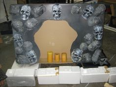 Cheap & easy fireplace facade with dollar store skulls