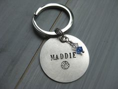 A 1.25 round solid sterling silver disc is stamped with one name and your choice of sport - WATER POLO