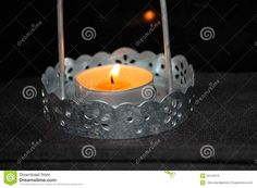 Candle in a candlestick, bright gorit. yellow flame, lighting the room romantika.na nintendo background