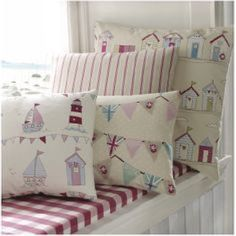 Fryetts -  Fryetts Fabric Collection - Beach and seaside themed fabrics covering cushions on a checked window seat, all in cream, red, pink and blue shades