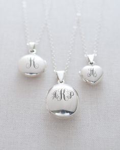 Sterling Silver Locket Necklace in round, heart of oval shapes. Engraved with up to 3 initials. Choose from 8 different font styles.