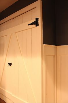 OH MY WORD!  I AM IN LOVE with these barn door closet doors!  @Emily Crump you need to help me DIY up an idea for a single door (C doesn't have double closest doors :(