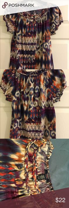 """Chaps Petit Medium Multi Colored Shirt NWOT This is an adorable shirt. It's neckline has a braid sewn into the shirt and the sleeves have elastic. It is navy, purple, red, orange, cream and burgundy. Beautiful array of colors! 100% cotton 21"""" length  34"""" bust Chaps Tops Blouses"""