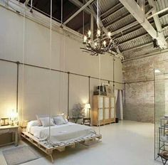 A little too open but the exposed beams, simple bedlinen and tough-chic chandelier work perfectly