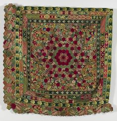 1875 - 1899. A central rosette surrounded by concentric borders of hexagons and frames made from strips of silk braids and ribbons likely to have been used for furnishings. Possibly made by Ellen Charnley (nee Smart) of Wigan.