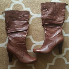 Guess Boots These beauties are knee-high (fits right below the knee) in length with a 4 inch heel. No damage. Worn only once. Like new condition. Medium width. Guess Shoes Heeled Boots