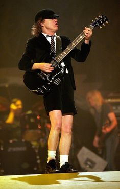 Angus Young Photos Photos - AC/DC Performing In Concert - Zimbio