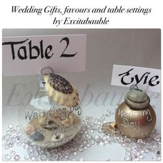 Beach themed Personalised glass Wedding Favours, Table Settings and Gifts with sand and shells  www.excitabauble.co.uk