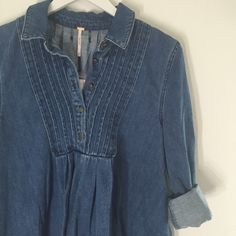 Free People! Brand new with tags. Super comfortable Jean like top. Size small but fits like medium. Free People Tops Blouses