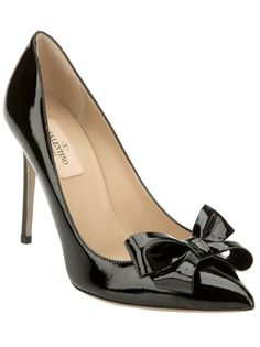 Black patent leather pump from Valentino featuring a pointed toe, a leather bow detail, a leather sole and a stiletto heel.
