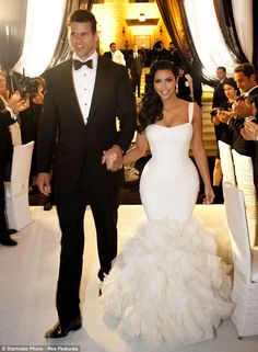 Making an entrance: Kris and Kim arrive at their reception to applause from guests. Dress Code, Perfection! I too want a strict dress code. LOVED that second Vera Wang dress!!!! It felt as if she picked it out of my brain. Sigh. <3