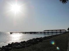 Sun setting behind the pier at Saint Simons Island, GA, United States