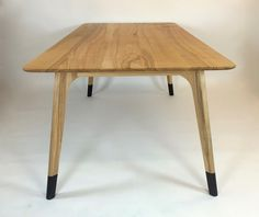 Retro socks. Dining table designed by Simon Morris, Lufufurniture.com. Ash with…
