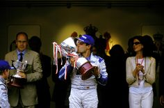 Juan Pablo Montoya kisses his trophy after finishing 1st in the Williams FW25, at the 2003 Monaco GP