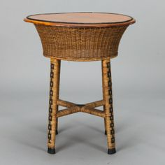1920s Round Wicker Side Table --- Circa 1915-1920 wicker based side table has a wood top, wicker base, crossed stretchers and four legs with contrasting decorative border of woven, open linked black squares. Pair of matching wicker armchairs sold separately. ---  Item: 5833 --- Retail Price: $895