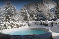 Round Hot Tub and Lots of Snowy Trees