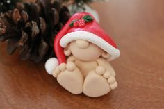 This listing is for one (1) hand sculpted polymer clay Christmas baby gnome. He sits approximately 1.5 inches tall. Hes sure to bring some cheer to