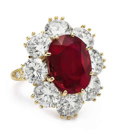 A RUBY AND DIAMOND RING, BY VAN CLEEF  ARPELS  Set with an oval-cut ruby, weighing approximately 8.24 carats, within a circular-cut diamond surround, the shoulders decorated with circular-cut diamonds, mounted in 18k gold, circa 1968, with French assay mark With maker's mark for Van Cleef  Arpels $4,226,500.00