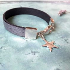 Silver star leather bracelet, sterling silver metallic steel leather bracelet • womens jewellery #silverleatherbracelet #starcharmbracelet #starbracelet #giftsforher #womenswear #womensfashion #giftideasforher #sterlingstarbracelet #womensaccessories #fashionistabracelet • A personal favourite from my Etsy shop https://www.etsy.com/uk/listing/551442330/silver-star-bracelet-sterling-silver