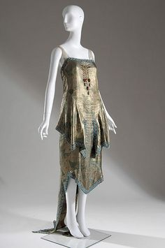 Gold lamé brocade evening gown with seed-bead trim and beaded brooch, by Callot Soeurs, French, 1921. Worn by Mrs. Potter Palmer II.