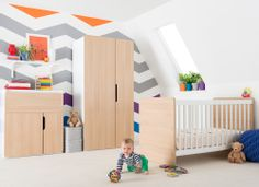Asymmetric doors and a mixed oak & white finish create a beautifully original collection of nursery furniture. The Oulu roomset consists of a fixed side cot bed, dresser and wardrobe, which will adapt to your little one's needs as they grow.