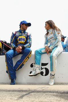 Chase Elliott, driver of the #24 NAPA Auto Parts Chevrolet, talks to Danica Patrick, driver of the #10 Nature's Bakery Chevrolet, on the grid during qualifying for the NASCAR Sprint Cup Series Duck Commander 500 at Texas Motor Speedway on April 8, 2016 in Fort Worth, Texas.