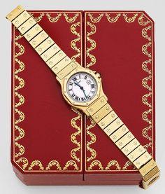 "Herrenarmbanduhr von Cartier sog. ""Santos de Cartier Ronde"". Gelbgold, gest. 750. Oktogonales Uhreng — Uhren"