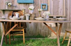rustic table setting with wood rounds and baby breath