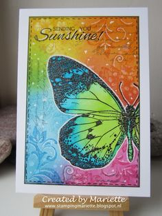 Stamping Mariëtte: Used distress inks for the bright part and IndigoBlu Big butterfly, Floral swirl, Peony posey, Poppycock & Script