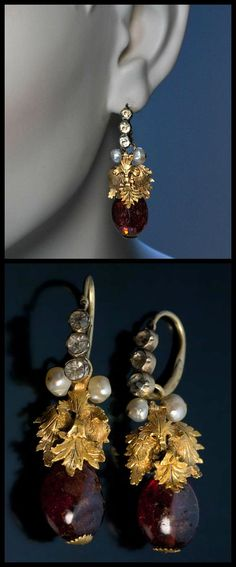 These Russian polished earrings date to the 18th century and feature 18k gold leaves, pearls, and paste embellishments. What do you think of them? (Via 1stdibs.)