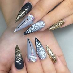 Ombre gold glitter stiletto with white swirl detailing! Beautiful nails by  @jonnydieppham  Ugly Duckling Nails page is dedicated to promoting quality, inspirational nails created by International Nail Artists  #nailartaddict #nailswag #nailaholic  #naila