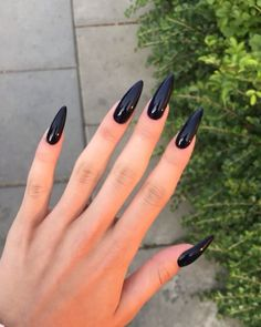 May 2020 - Black stiletto nails are fierce and bold. They are oval shaped nails that are more pointed than rounded at the tip, and are usually very long. Since they're so long, they're almost always fake. They look cool, and are very extreme. Black Stiletto Nails, Black Acrylic Nails, Long Black Nails, Black Almond Nails, Black Pointed Nails, Long Oval Nails, Stiletto Shaped Nails, Oval Shaped Nails, Bling Nails