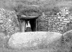 Newgrange passage tomb is one of Ireland's most important and oldest archaeological sites. This photograph was taken before the excavation that uncovered the roof box through which the winter solstice sun lights up the ancient tomb.  Format: Glass Negative    Date: ca. 1904 - 1910  The interior is amazing but the passage to get there is incredibly claustrophobic.  (Source: irish-history)