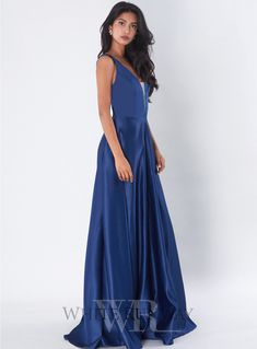 Brisa Gown. A beautiful full length gown by Tinaholy. A plunged style featuring mesh on the front and a full flared skirt.