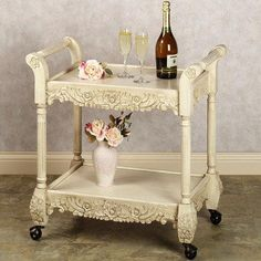 The lovely, practical Viviana Rolling Serving Cart features two generous shelves to hold beverages and snacks for an evening of entertaining. Handcrafted wooden cart has an antique ivory... M