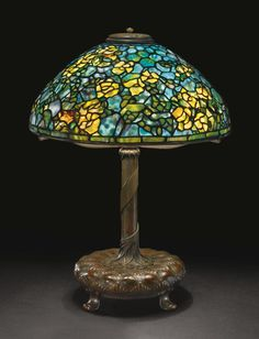 """Alternate Views           A RARE """"RAMBLING ROSE"""" TABLE LAMP base impressed 26874/TIFFANY STUDIOS/NEW YORK  leaded glass and patinated bronze  22  1/2  in. (51.2 cm) high 16  1/4  in. (41.3 cm) diameter of shade  circa 1905                                                            ..."""