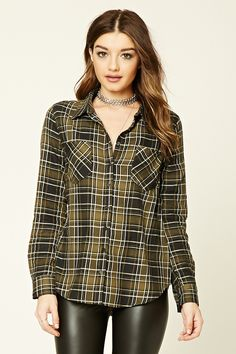 A cotton button-down woven shirt featuring an allover plaid print, a basic collar, two front patch pockets, long sleeves with buttoned cuffs, and a curved hem.