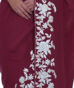 <p>Heritage Parsi Gara needlework has been considered one of the finest needlework befitting heirlooms passed down the generations. From our Heritage Parsi Gara Collection, this is a burgundy colour pure crepe Parsi Gara hand embroidered saree with